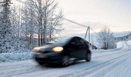 car moving down snowy road