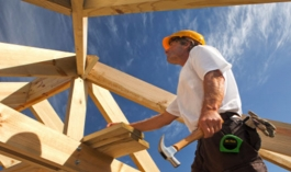 Man working on wooden structure construction